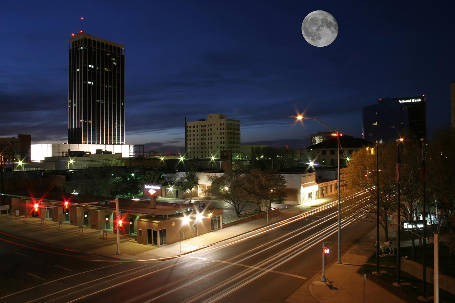 Businesses line illuminated city streets in Amarillo at night