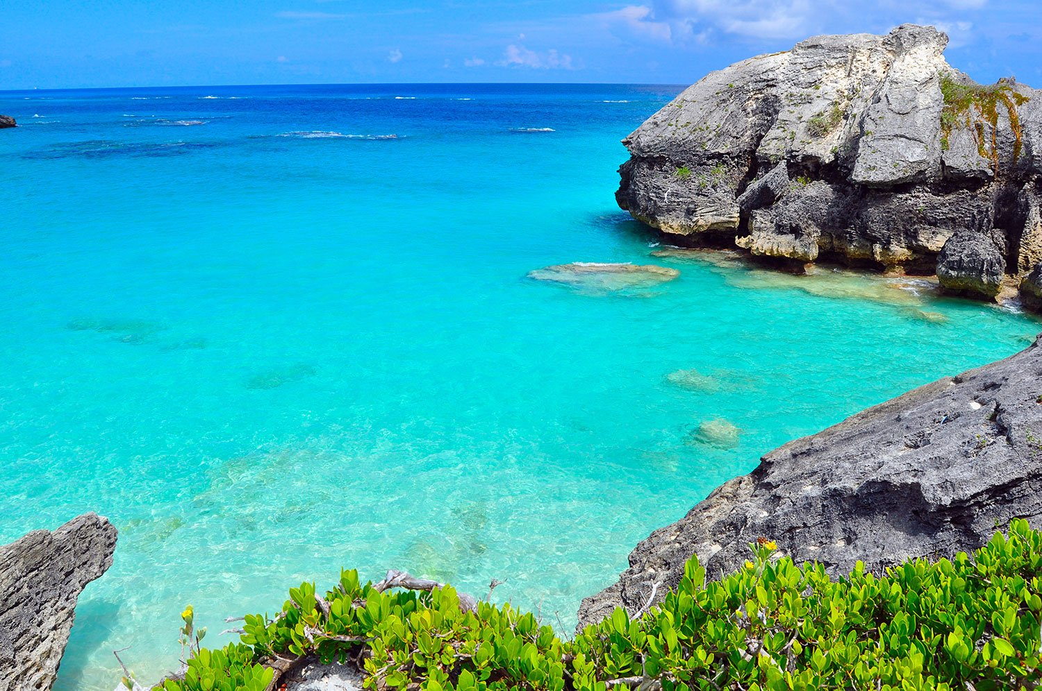 Turquoise water in Bermuda partially enclosed by large rocks