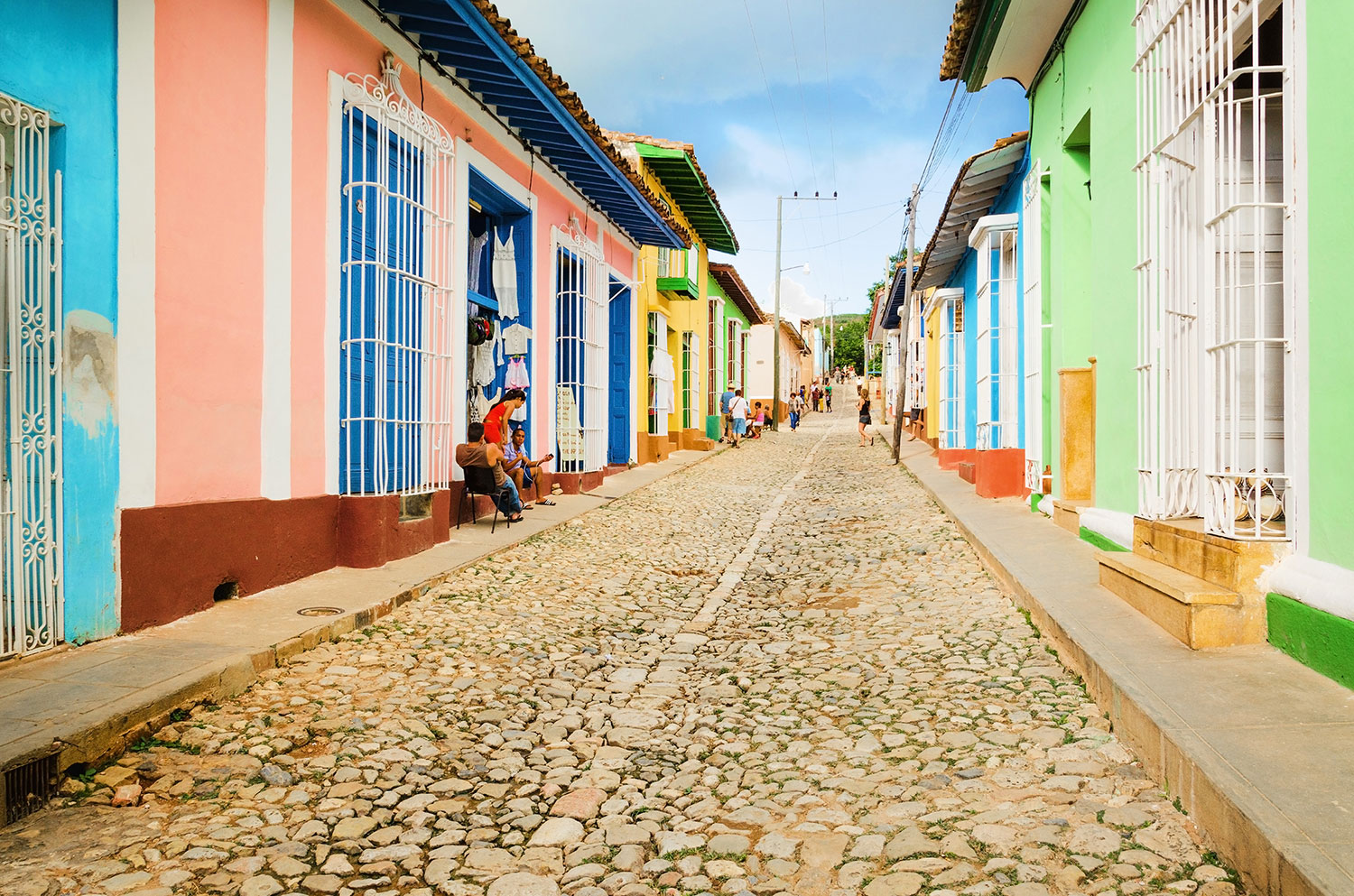 Stone road lined by colorful houses in Cuba