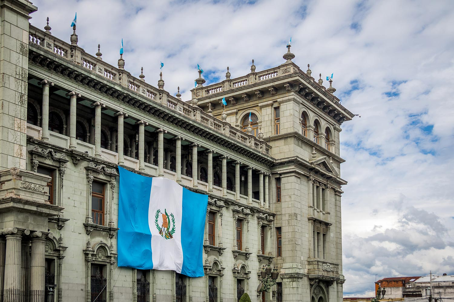 Exterior of the National Palace with the Guatemalan flag on display in Guatemala City