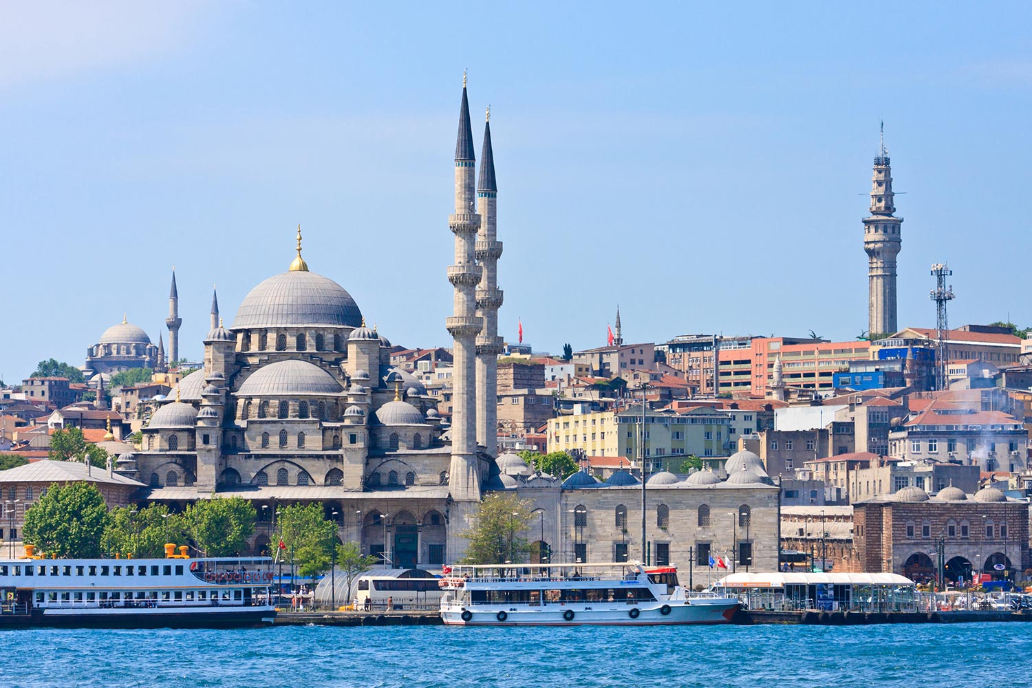 Cityscape of Istanbul next to turquoise water