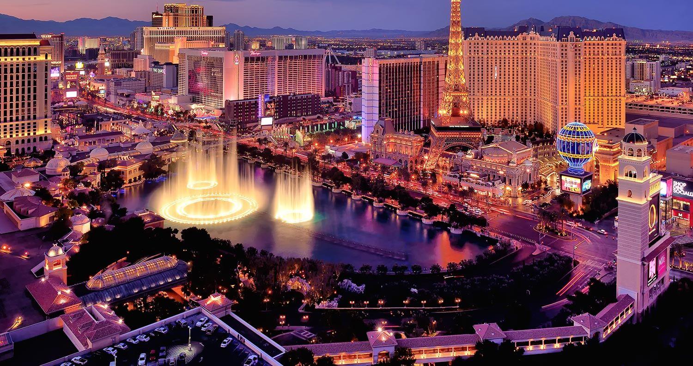 Illuminated buildings in downtown Las Vegas at dusk