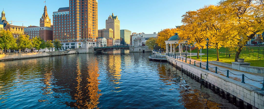 A water canal flows through downtown Milwaukee in autumn