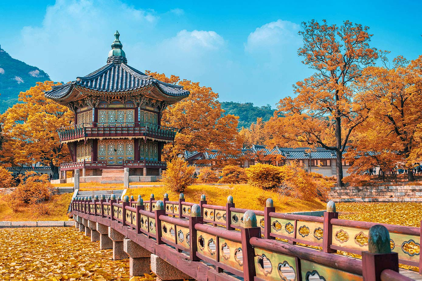 Traditional bridge surrounded by orange and yellow foliage in Seoul