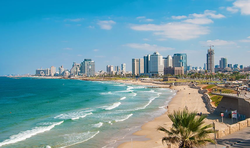 Water meets the sandy beach in Tel Aviv