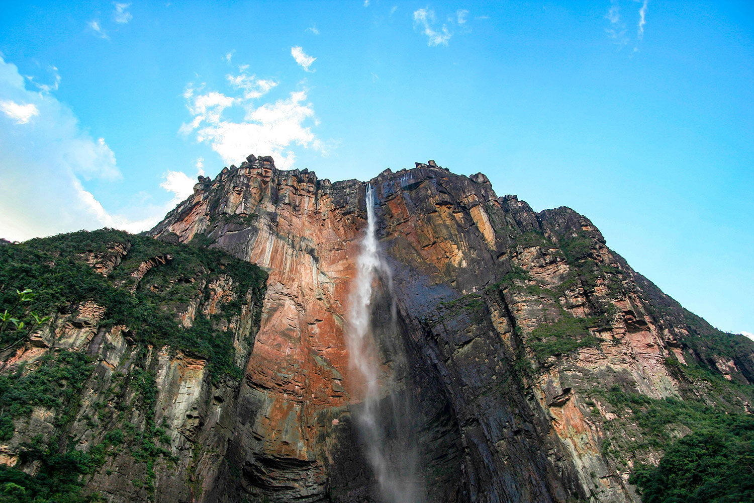 An upward view of a tall waterfall in Venezuela