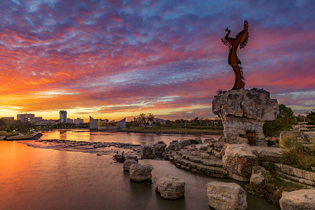 Rock formations line the water in Wichita at dusk