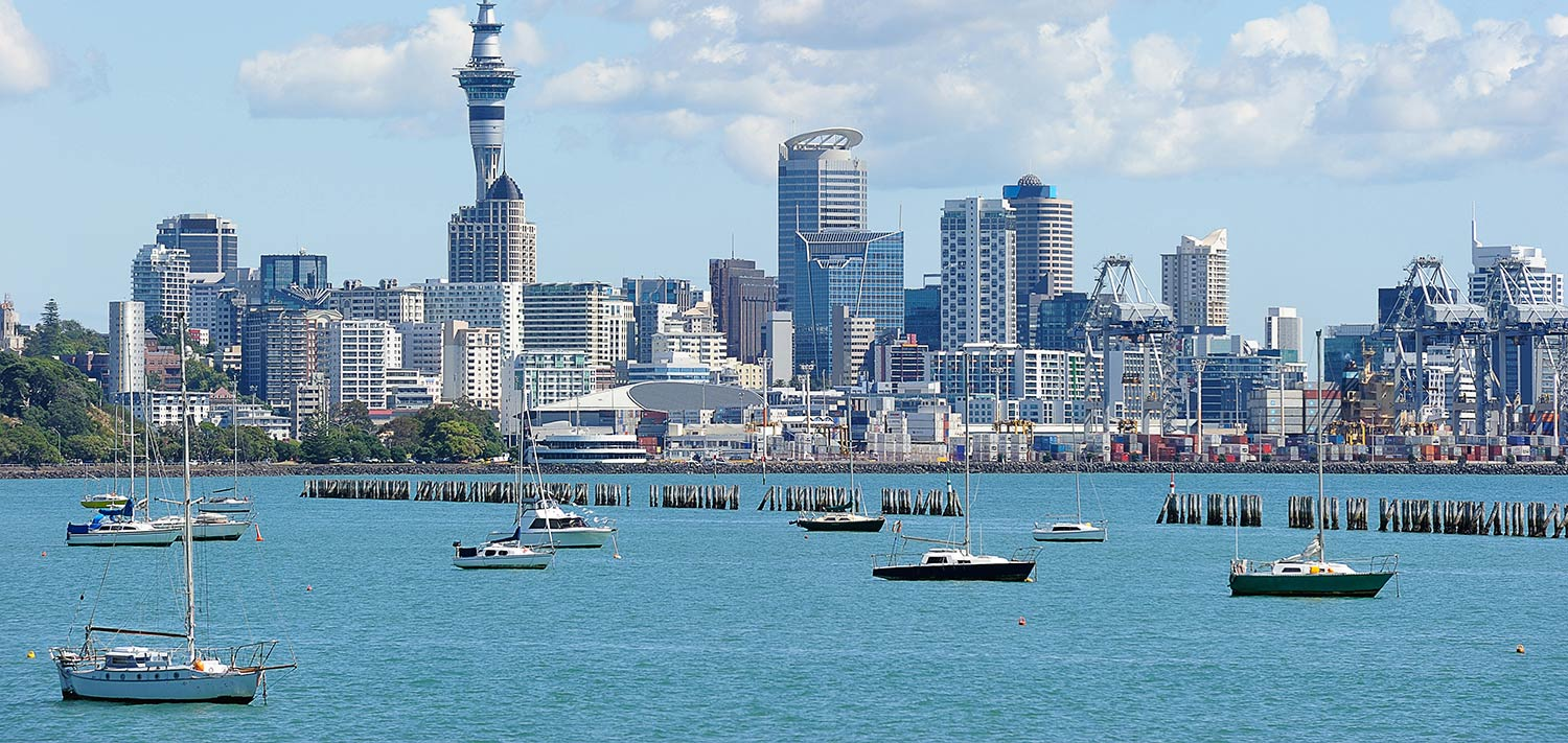 Auckland cityscape with sailboats in the harbor