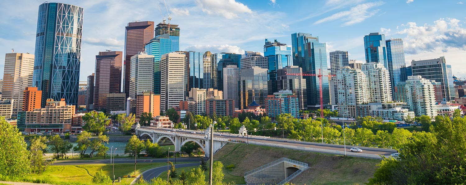 Cityscape in Calgary with skyscrapers and a long bridge