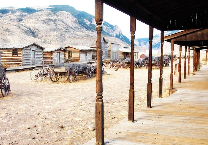 Old Western style wooden homes and wagons in Cody