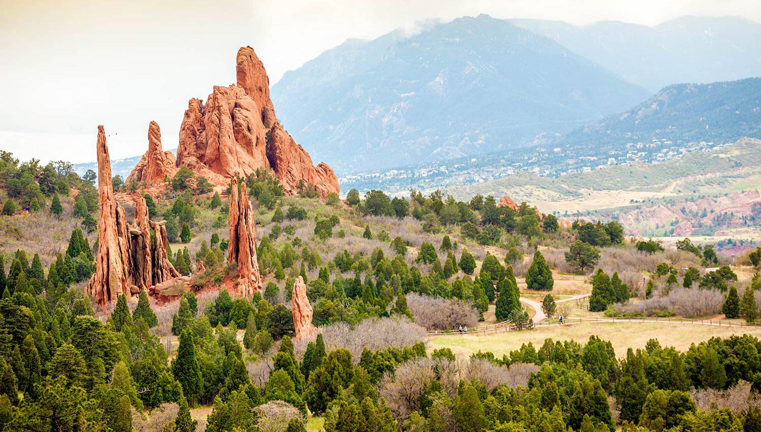 Pointed rock formations on a hill with sparse trees in Colorado Springs