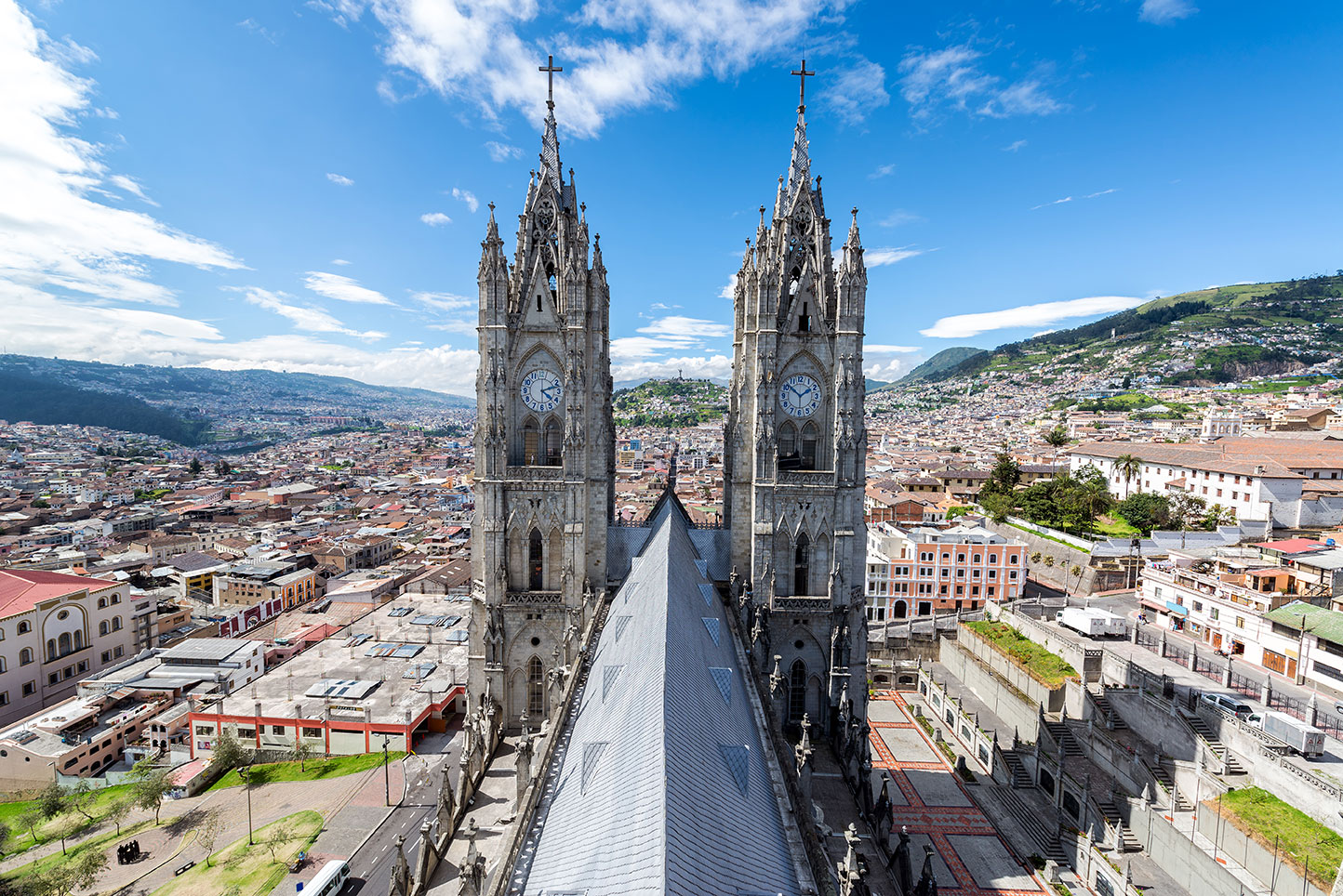 Twin steeples of the Basilica overlooking a city in Ecuador