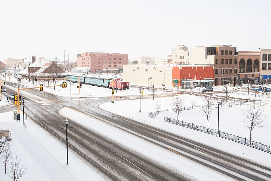 Recently plowed streets and snow-covered buildings in Fargo