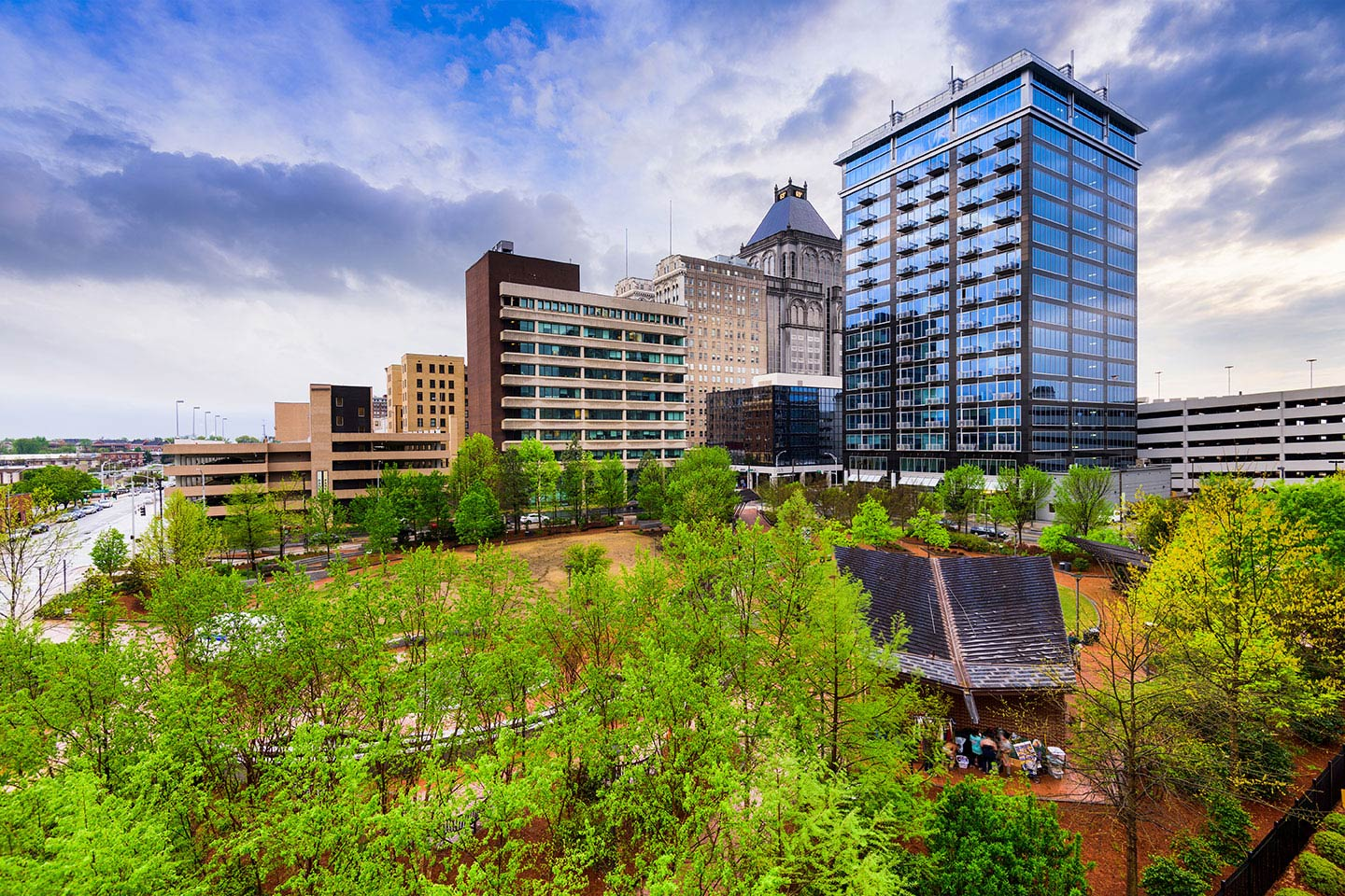 Downtown skyline of Greensboro lined with trees