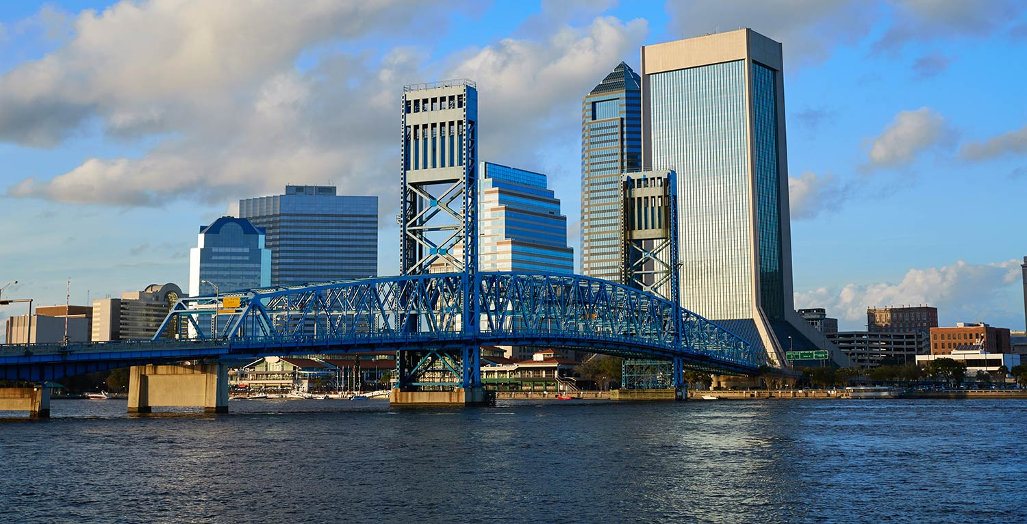 A blue steel bridge and several skyscrapers in downtown Jacksonville