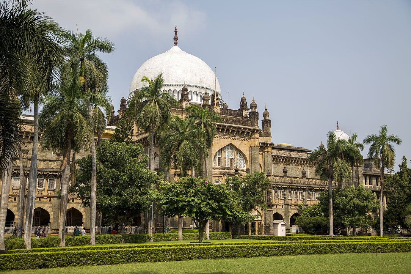 A traditional building surrounded by green trees in Mumbai