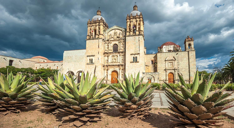 Dark storm clouds loom over a building in Oaxaca