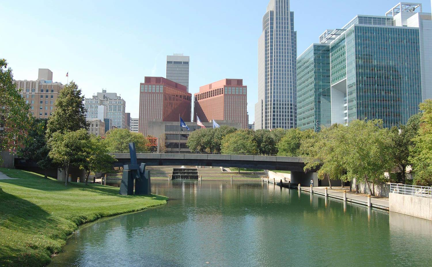 A river runs alongside downtown Omaha