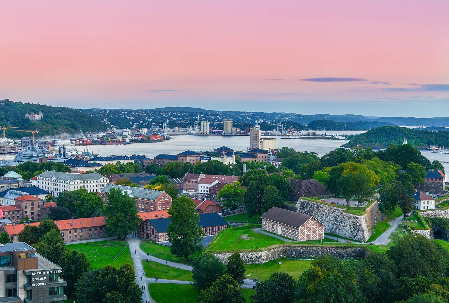 Aerial view of Oslo illuminated by a pink and orange sky
