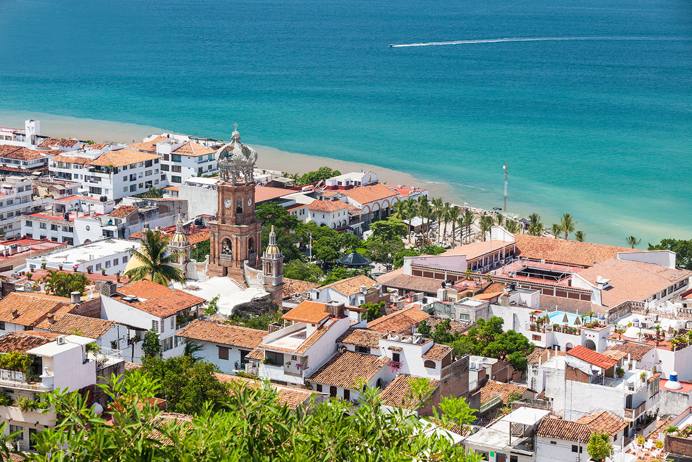 Homes near turquoise water in Puerto Vallarta