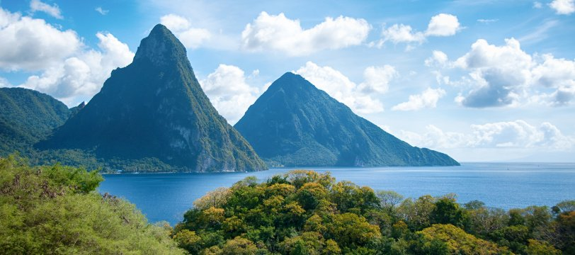 Large green hills next to deep blue water in Saint Lucia