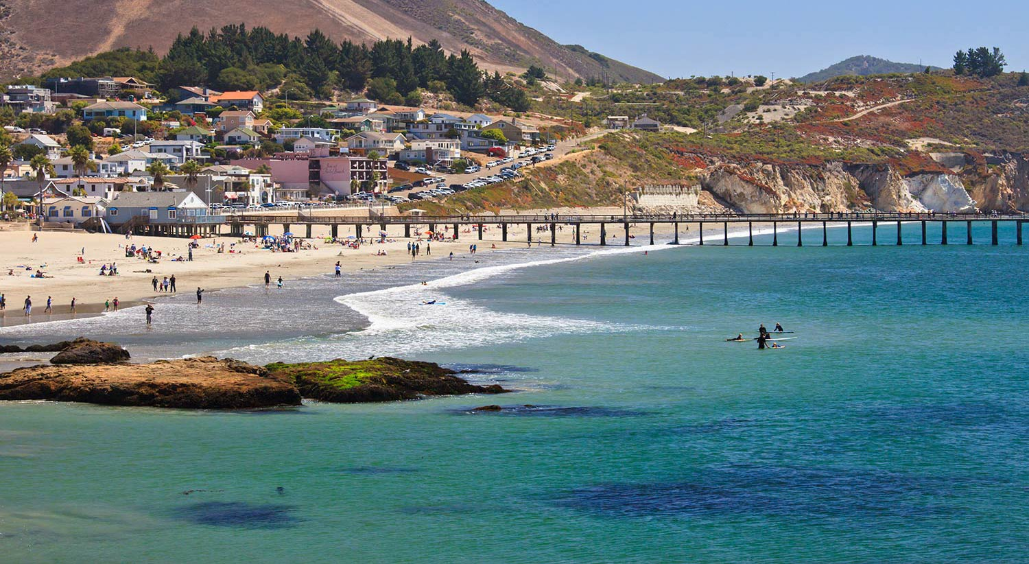 Blue-green water along the sandy coastline in San Luis Obispo