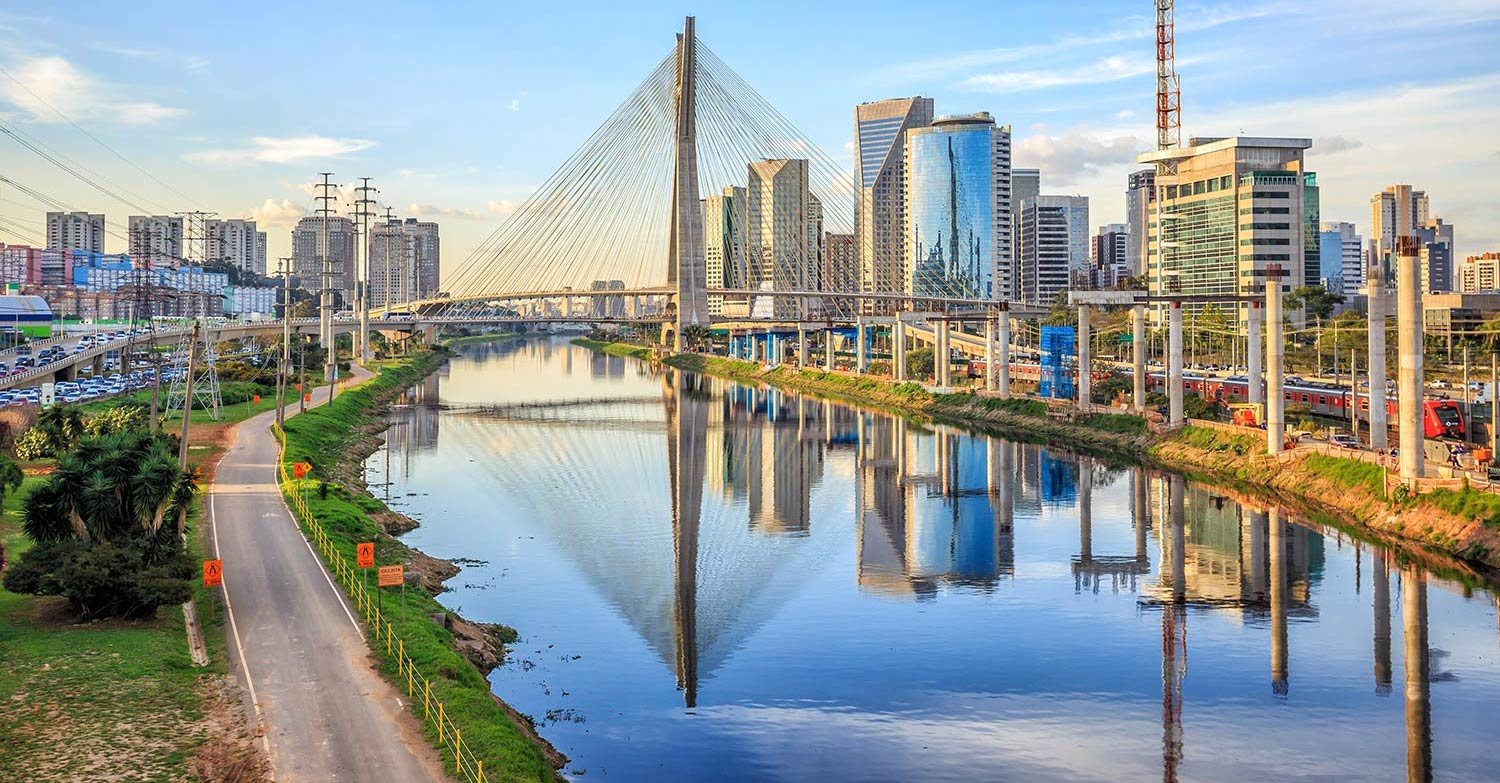 Urban buildings reflect off glassy water in Sao Paulo