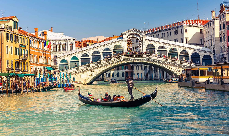 A lone gondola floats on a Venice canal